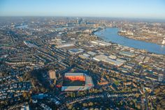 Canary Wharf and London's financial district sit in the background of this aerial shot of Charlton Athletic's The Valley Charlton London, Charlton Athletic Football Club, London Football, Paisley Scotland, Sports Stadium, Stamford Bridge, Football Stadiums, World Cities, City Photo