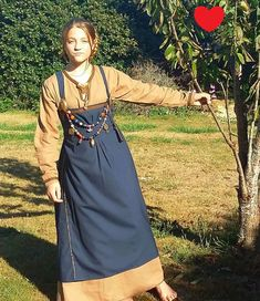 Historical Hangerock or Apron Dress  Get noticed at the next Renaissance /medieval fair! with this Viking dress Replica Youll for sure turn Heads!  Made of Blue cotton blend fabric... it has a nice drape and wrinkles very little.  Dress comes complete with Tunic which is made of 100% light weight linen in Brown.  TUNIC: has an open key hole neck opening ready for a viking brooch to hold it closed,  Tunic can also be worn without a Brooch.  The neckline and sleeves adorn viking Inkle weav...