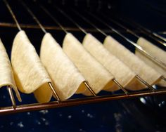 pinner says DIY taco shells.  I actually baked them draped over the oven racks.  They only took a few minutes to crisp up.  Be careful though - they go from not done to done in a flash.  I actually burned my first batch because I walked away.  Luckily I had a whole package of corn tortillas to play with.