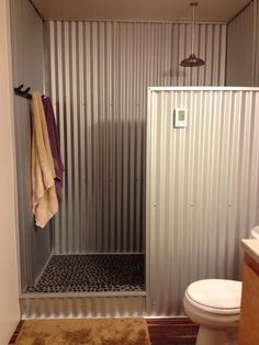 Galvanized corrugated metal shower surround--use z channel over PVC faux wood piece to protect against water damage. Description from pinterest.com. I searched for this on bing.com/images