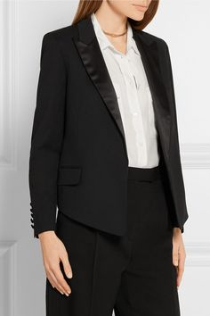 Kate Moss for Equipment is an iconic collaboration between the international supermodel and cult contemporary brand. Tailored from wool-twill, this tuxedo-style 'Wynne' blazer is defined by padded shoulders and trimmed with satin at the peaked lapels. The star-print lining and relaxed fit give it a signature rock'n'roll feel.