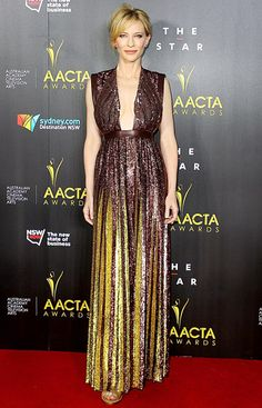 2014Blanchett brought her A-game to the AACTAs! The Blue Jasmine star attended the 3rd annual awards show in Sydney, Australia, flaunting some cleavage in a sparkly eggplant and gold-colored Givenchy gown with a plunging square neck