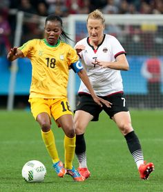#RIO2016 Melanie Behringer of Germany vies for the ball with Felistas Muzongondi of Zimbabwe during a Rio 2016 Olympic Games first round Group F women's...