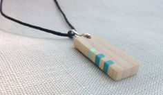 Tiny wooden pendant with pastel blue inlays. by Melcreationsbois, €20.00