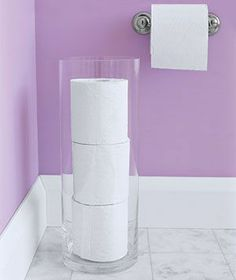 A tall vase for your extra toilet paper Clean and elegant too!