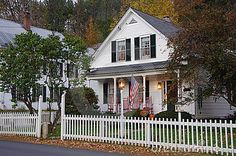 White clapboard house with a white picket fence- I guess we will need a picket fence