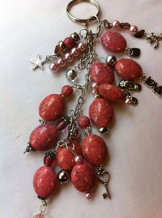 Pink beads, silver chain, and silver charms key chains on Etsy, $15.00