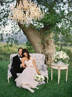 The glam chandelier, the vintage sofa, the beautiful couple--this photo is pure perfection! Photo: Jose Villa