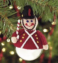 Dress up an ordinary glass ornament with a crocheted toy soldier ornament topper. Size: 3 not including hanger or ball. Designed to fit glass ornament 2 to 2 in diameter. Christmas Crochet Patterns, Crochet Christmas Ornaments, Christmas Knitting, Christmas Crafts, Christmas Decorations, Crochet Amigurumi, Crochet Toys, Free Crochet, Crochet Winter