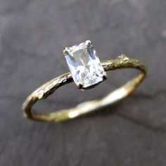 EMERALD CUT WITH A BRANCH BAND