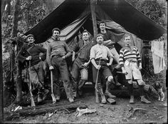 Photograph of hunters outside tent in the bush, [ca 1900s] by National Library NZ on The Commons, via Flickr
