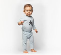 The cashmere Sweater with Star is the perfect Baby Gift! Send on its own, or add the pant and blanket for a luxurious matching set. Available in pink and blue.