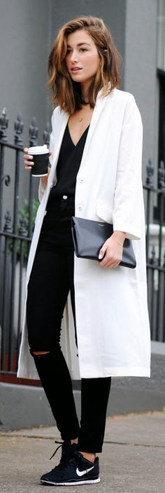 Carmen Hamilton is wearing a white coat and black jeans from Asos, black camisole from J Brand, black sneakers from Nike and the black clutch is from Saint Laurent