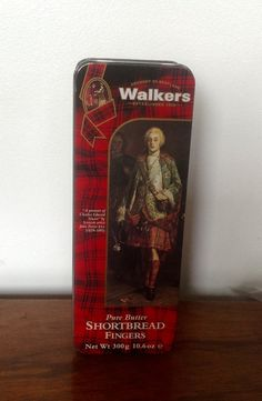 A 10.6 oz/300g Walkers Shortbread Tin, with a portrait of Charles Edward Stuart by John Pettie RSA.  The tin contained pure butter shortbread fingers and still has the original best before sticker, dated 28-02-96. Tin measures 9 long, 3.3 wide and 1.7 high. In very good condition.