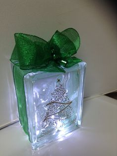 """""""Seasons Greetings Christmas Tree"""" design laser etched in gold, with green ribbon embellishment and LED battery operated cool lights to add an extra special touch to your holiday decor....personal message me for color details if you are interested in this design for yourself or as a gift for that special someone. Laser etching by Lavene & Co."""