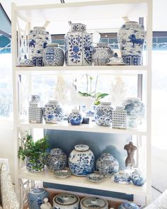 Blue and white plates bowls and ginger jars soaking up some sunshine in our Baltimore shop