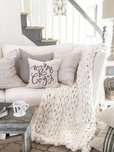 This throw is so soft and warm and just the right size for cuddling up on a rainy (or snowy) day with a book. The next thing you know, you have had the best nap of your life! #artizenchunkythrow #largechunkythrow #ad #comfy #chunkyknitwoolthrow