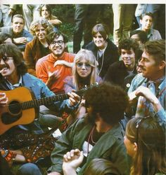 George Harrison and Patti Boyd in at a park 60s style...The guy in the red sweater looks so darn happy to be there!