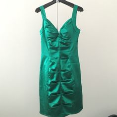 """Clearance - bundle and save! green mini dress  Mini dress in beautiful emerald color ...has light cushioning in bust .... Back zip detail - 33"""" length  in great condition - just a bit small thread hanging loose at back- nothing noticeable - ask me for bundles - 2 items get 15% off and 3 or more get 20% off  can't model as it doesn't fit me ! Morgan & Co. Dresses Mini"""