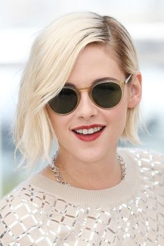Stewart wore her bob parted low on one side for the [i]Personal Shopper[/i] photocall at Cannes, offset by matt red lips.