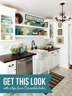 Love the white cabinets and dark counter tops. Especially love the large shelves spanning the cabinets over the sink.