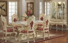 Victorian Style Dining Room In White And Burgandy