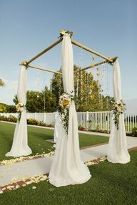 Beach Wedding Ceremony Decoration - full bamboo arbor with tulle and floral ties