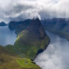 "2/3 The second shot of today's Faroe Island series. If you're looking for somewhere unique and ""off the map"" to visit - this is your destination! Amazing views and a spectacular landscape of green jagged peaks. #FaroeIslands' #BALLWatch #ShotOnCanon #CanadianCreatives #MountainCultureElevated by paulzizkaphoto"