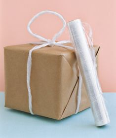 Carry unwieldy packages by twisting several feet of wrap into a sturdy rope, tying it around a box, and knotting the rest into a handle.