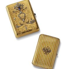 Gifts from the Imperial Family: two cases by Carl Faberge bearing the Romanov Eagle, one in gold with diamonds and sapphires the other in sumptuous yellow enamel. Potent presentation gifts from the Russian court.