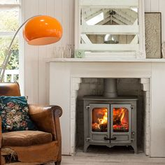 Charnwood 'Island II' wood burning stove in pewter, Relaxing Places, Log Burner, Living Room Inspiration, Kitchen Living, Elle Decor, Innovation Design, Home Appliances, Stoves, Pewter