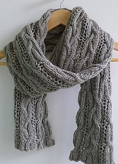 This scrumptious scarf was designed for a yarn produced from an alpaca named Mercurio, whose yarn was part of the Kickstarter project from Adagio Alpaca Mills. It is light and warm, but looks chunky and textured from the use of ribbed cables.