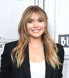 """""""Full, choppy, piecey bangs that extend from from lash-length to jawbone-length are perfect for round faces,"""" says Scarlett. Elizabeth Olsen demonstrates the look flawlessly, and Scarlett also cites Goldie Hawn's iconic long bangs as a style reference. Fringe Hairstyles, Hairstyles For Round Faces, Hairstyles With Bangs, Cool Hairstyles, Shaved Hairstyles, Casual Hairstyles, Medium Hairstyles, Short Hairstyle, Hairstyle Ideas"""