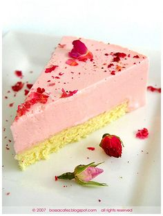 Rose Tea Cheesecake - Rose tea-infused cheesecake with a vanilla genoise sponge base, topped with fresh rose petals and dried rose buds.