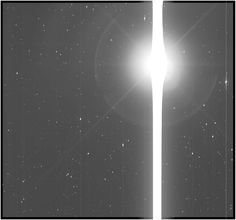Kepler image of Earth, a saber-like saturation bleed across the instrument's sensors