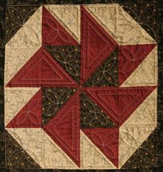 half-square triangles, squares cut 2 7/8 and cut once in half diagonally. 4 brown, 6 red and 6 cream - Barbara Brackman blog