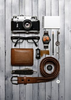 {story} telling.. a perfect prop box! - wallet, glasses, vintage camera, watch, notebook, belt, pencil film, men's style, masculine, prop styling, photography styling -