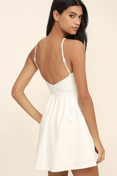 A sweet silhouette and perfect fit make the Oui Oui White Backless Skater  Dress our   a03b86c2f
