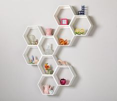 Honeycomb Wall Shelves from Land of Nod - love this modern look for a nursery or kids room!
