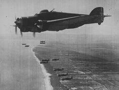Italian bomber SM.79 'Sparviero' flies with fighter escort Macchi C.200 'Saetta'.