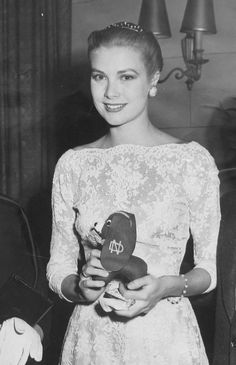 Yes yes I know it's Grace Kelly but my dad gets a shoutout for this one bc I think she's holding Notre Dame memorabilia (see the ND overlapping logo in her hand)!!!