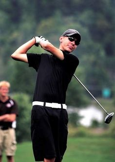 New Philadelphia's Logan Murphy tees off during Wednesday's match against Claymont at Five Waters Golf Course in Midvale.