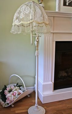 I love this romantic look!! Lampshade frame, old lace, and crinoline fabric. Cut lace add Fabri-Tac, glued lace on in sections. Hand sew crinoline fabric.