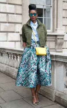 Marsha Campbell from Street Style: Midi Skirts  Wears Topshop shoes, jacket and shirt, Chanel broach, Kite sunglasses and an L.K Bennett skirt and bag