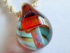 Hand Blown Boro Glass OOAk Mushroom Pendant on Handmade Natural Hemp Twist Necklace by EssentiallyErin on Etsy