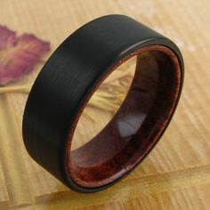 Very fashion forward and beautiful flat band ring with a black tungsten band over a genuine wood inner band. A marvelous ring! Wholesale Tungsten Rings | Wedding Bands. www.925express.com