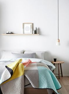 ❤️ grey decor white walls wooden flooring hanging bulb lighting design style pop of colour quilt shelf with pictures
