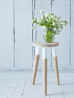 This gorgeous three-legged stool nicely combines sections of clean, white paint with bare, rustic wood.