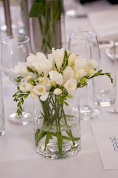 Wedding fresia centerpiece. I saw this with red roses. Lovely.