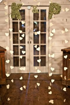 the hearts are a really sweet touch and would be simple to make and personalize with color.  the moss letters can be taken out or done with a simple drawing of your monograms.  again, you would still need a backdrop to cover the door.